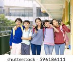 group of happy smiling primary... | Shutterstock . vector #596186111