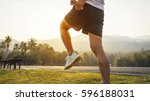 close up young man runner warm... | Shutterstock . vector #596188031