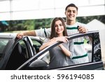 excited couple buying a car at... | Shutterstock . vector #596194085