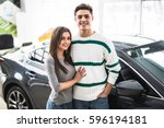 beautiful young couple standing ... | Shutterstock . vector #596194181