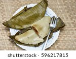 Small photo of Ila Ada Sweet rice dumplings. Elayada - steamed rice cakes wrapped in banana leaves famous breakfast or snacks of Kerala India.