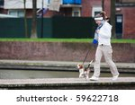 Stock photo girl walking with her dog on the leash beagle puppy 59622718