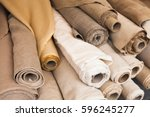 rolls of  linen cloth lie on... | Shutterstock . vector #596245277