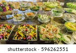 buffet with sushi  salad  ham... | Shutterstock . vector #596262551