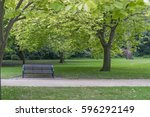 bench in a park on a summer's... | Shutterstock . vector #596292149