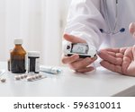 measuring blood sugar | Shutterstock . vector #596310011