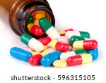 Colorful Pills In A Glass...