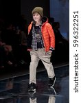 Small photo of Moscow, Russia - February 21, 2017: CPM, International Fashion Trade Show, collections for autumn-winter 2017, on the catwalk models present a new style children's collection for boys.