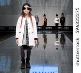 Small photo of Moscow, Russia - February 20, 2017: CPM, International Fashion Trade Show, collections for autumn-winter 2017, on the catwalk models present a new style children's collection for girls.