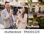 loving couple having an ice... | Shutterstock . vector #596331125