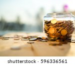 upside down the jar of coins on ... | Shutterstock . vector #596336561