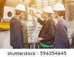back engineers in mechanical... | Shutterstock . vector #596354645
