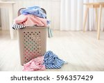 pile of clothes in plastic... | Shutterstock . vector #596357429