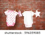 clothesline with hanging baby... | Shutterstock . vector #596359085