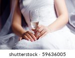 champagne in a hand of the bride | Shutterstock . vector #59636005