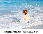 adorable little blond kid boy... | Shutterstock . vector #596362544