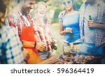 friends having a barbecue party ... | Shutterstock . vector #596364419