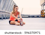 young athletic woman stretching ... | Shutterstock . vector #596370971