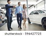 salesman presenting special... | Shutterstock . vector #596427725
