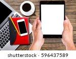 hand using digital tablet on... | Shutterstock . vector #596437589