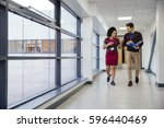 two teachers are walking and...   Shutterstock . vector #596440469