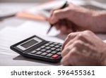 male hand using calculator ... | Shutterstock . vector #596455361