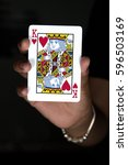 card hand holding king hearts... | Shutterstock . vector #596503169