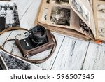 an old film camera and family... | Shutterstock . vector #596507345