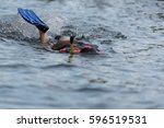 young woman swimming underwater ...   Shutterstock . vector #596519531