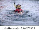 young woman swimming underwater ... | Shutterstock . vector #596520551