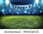 football pitch and blue lights  | Shutterstock . vector #596526515