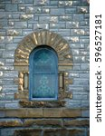 Small photo of Isolated stained glass church window with ionic columns. Copy space.