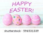 easter eggs on wooden background   Shutterstock . vector #596531339