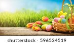 basket of easter eggs with... | Shutterstock . vector #596534519