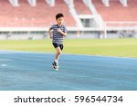 Young Asian Boy Running On Blu...