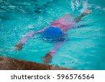 little girl swim in swimming... | Shutterstock . vector #596576564