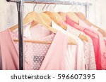 pink womens clothes on hangers... | Shutterstock . vector #596607395