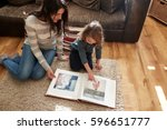 mother and daughter at home... | Shutterstock . vector #596651777