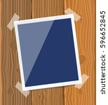photo frame on the board. eps 10 | Shutterstock .eps vector #596652845
