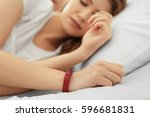 young woman with sleep tracker... | Shutterstock . vector #596681831