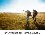 young couple of travelers... | Shutterstock . vector #596683259
