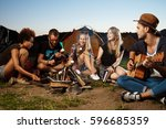 friends sitting near bonfire ... | Shutterstock . vector #596685359