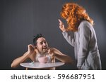 adult dressed as a baby eating... | Shutterstock . vector #596687951