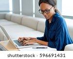focused young businesswoman... | Shutterstock . vector #596691431