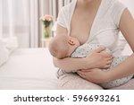 young woman breastfeeding her... | Shutterstock . vector #596693261