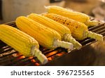 five grilled corn on the cob at ... | Shutterstock . vector #596725565