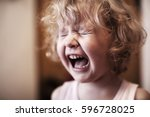 crying  little girl. sad baby.  | Shutterstock . vector #596728025