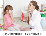 cute little girl at speech... | Shutterstock . vector #596748257