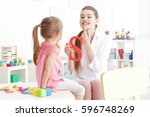 cute little girl at speech... | Shutterstock . vector #596748269