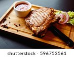 beautiful juicy pork steak... | Shutterstock . vector #596753561